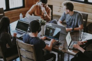 group of people using laptop computer