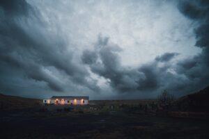 cloudy sky over lighted house