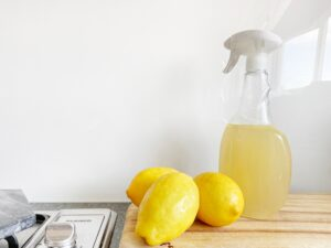 yellow lemon fruit beside clear glass bottle