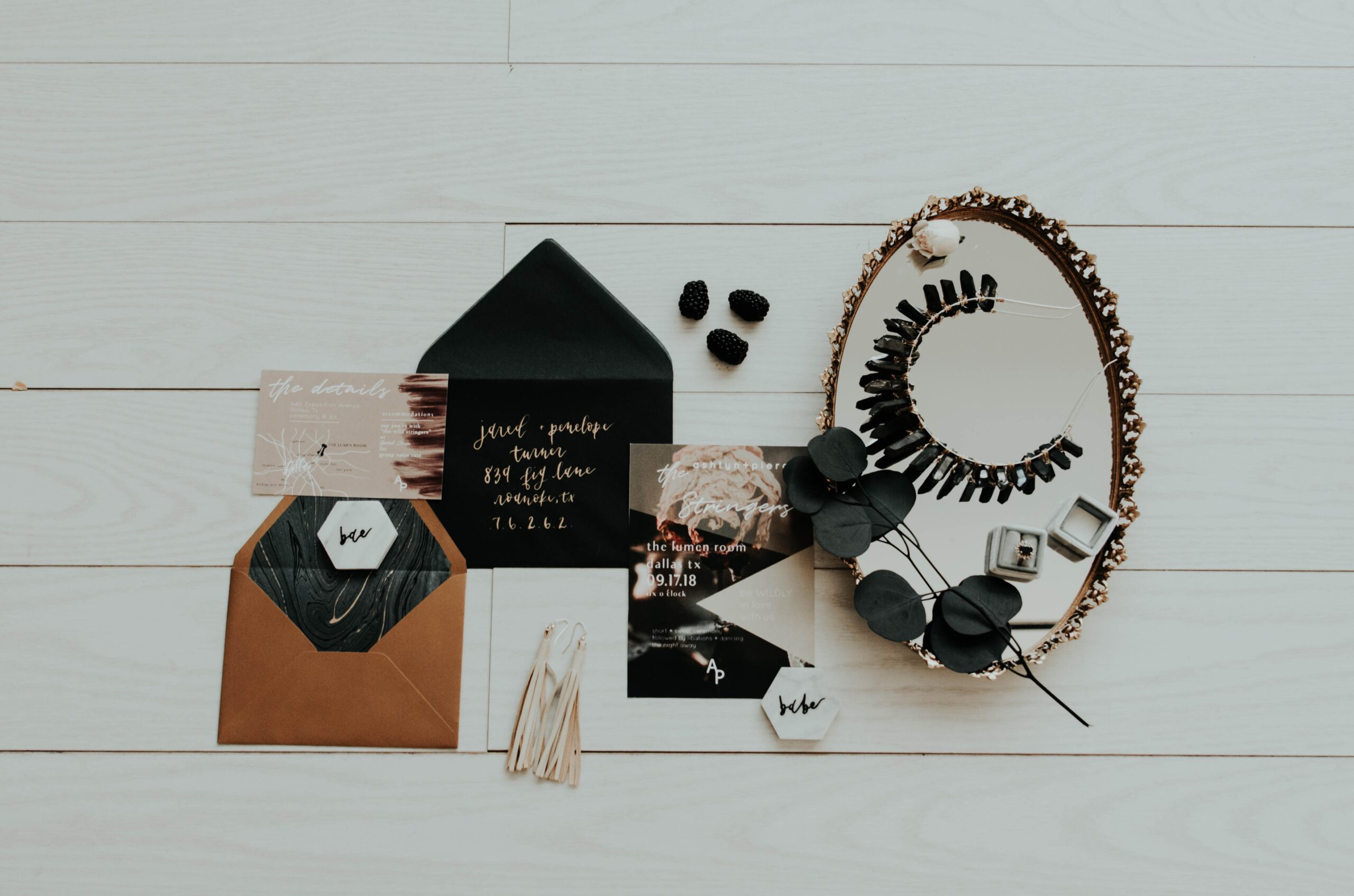 flat lay photography of mirror and envelopes