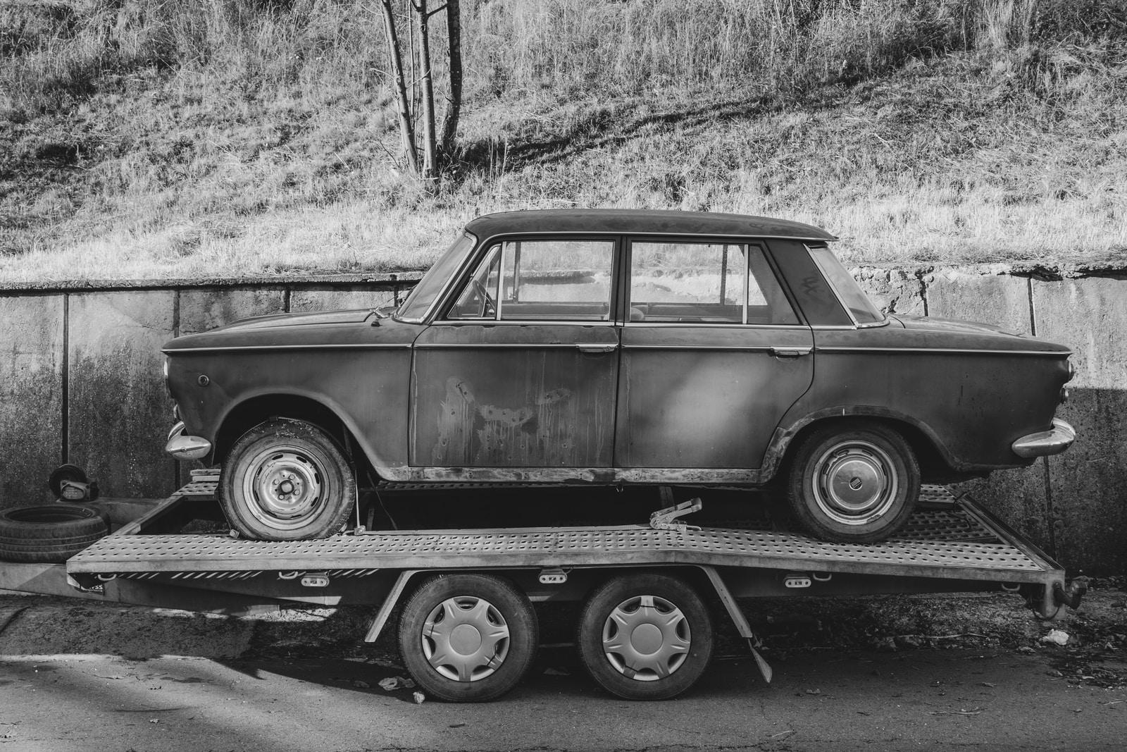grayscale photo of sedan on panel