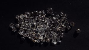 pile of clear stones on black surface